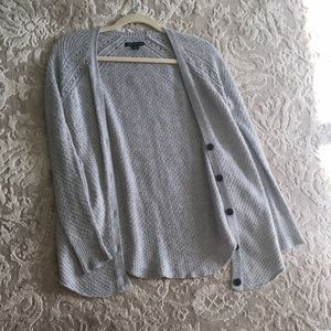 Light grey knitted cardigan with 4 medium buttons